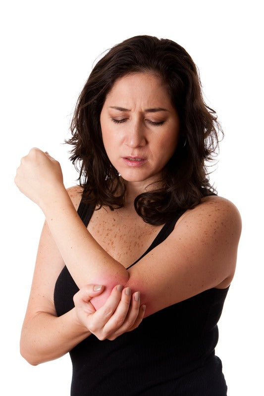 woman in pain from tennis elbow