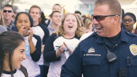 Massive mob overwhelms school's favorite police officer!