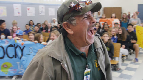 Students trick their favorite custodian and he walks into surprise of his life