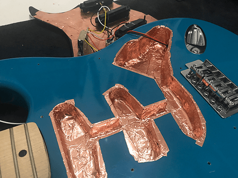 lining the cavities of the guitar