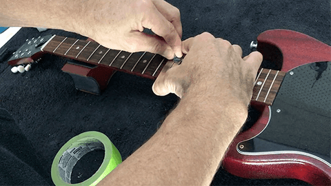 cleaning and polishing the fretboard