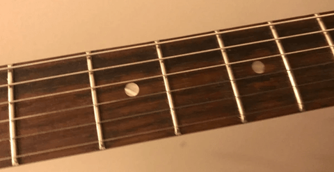 Unsealed fretboard cleaning
