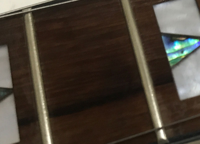 Repaired Fretboard