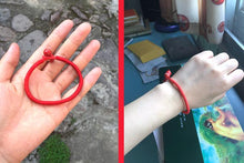 Red string bracelets from the Buddhists of Tibet