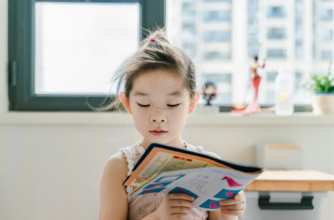 young girl reading, learning and inspiration for personal growth