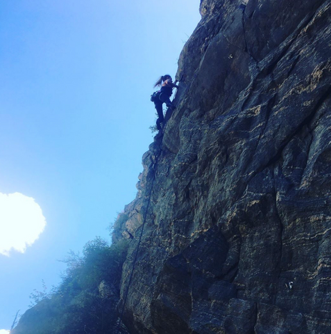 women's empowerment through rock climbing, founder Natalie Levy scales the wall outside Denver