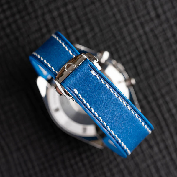Turquoise Maya Omega-Style Deployant leather strap with white hand-stitching