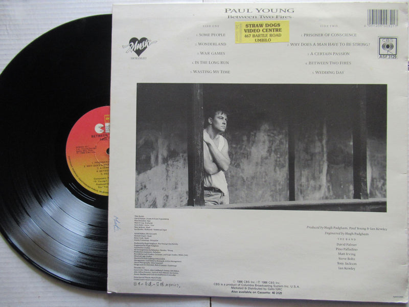 Paul Young | Between Two Fires ( RSA VG+ )