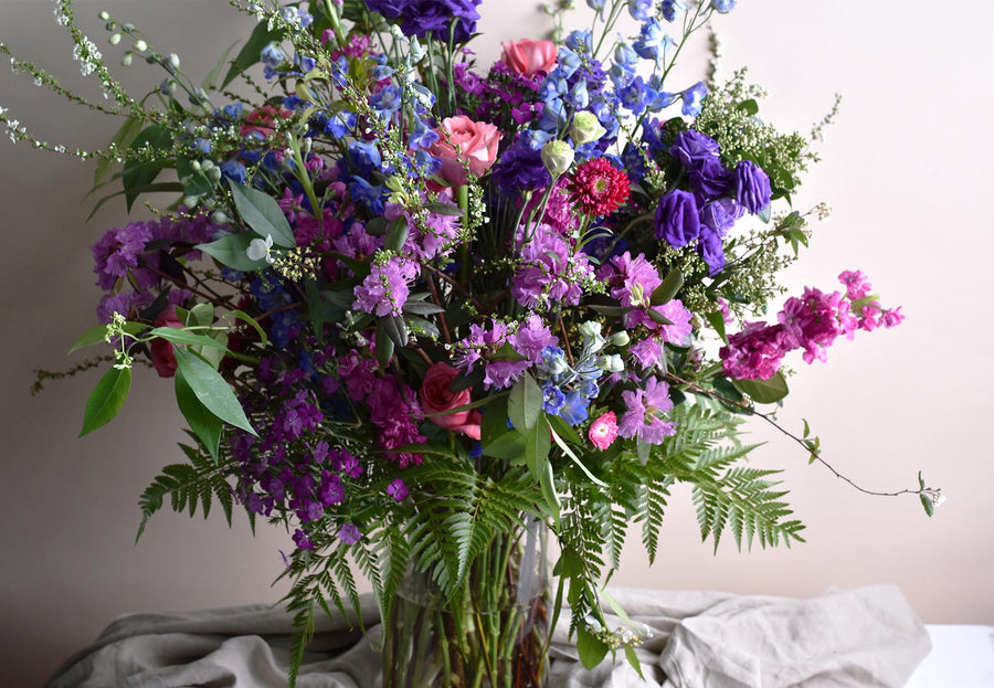 bright flowers sizeable vase arrangement