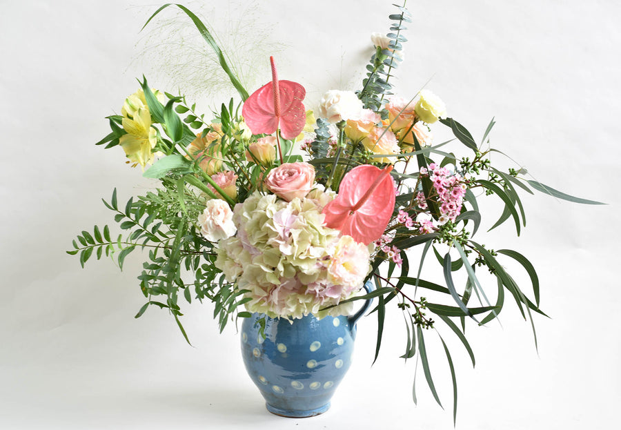 Pastel arrangement in a jug