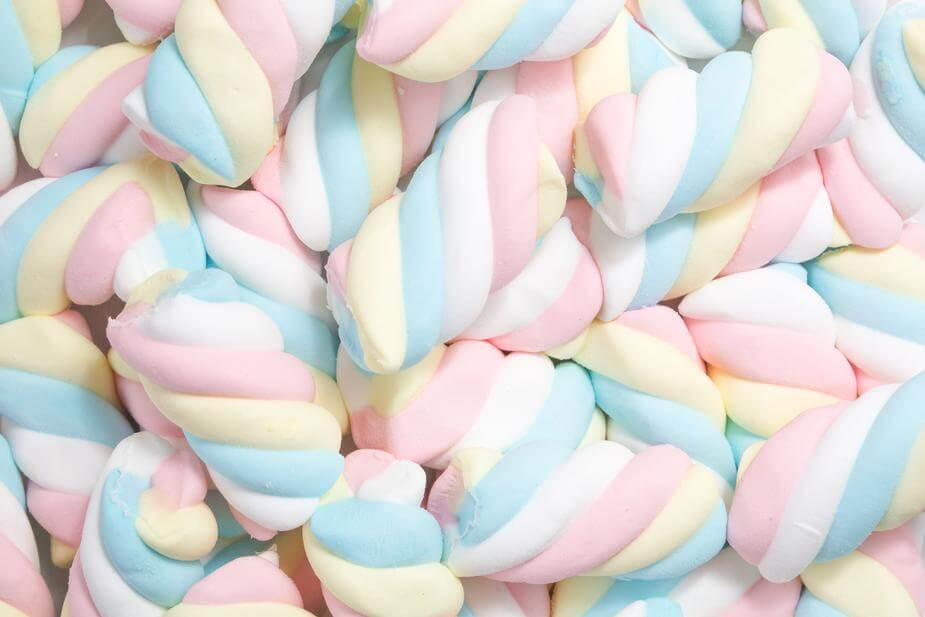 A closeup of a pile of spiraled, colorful marshmallows
