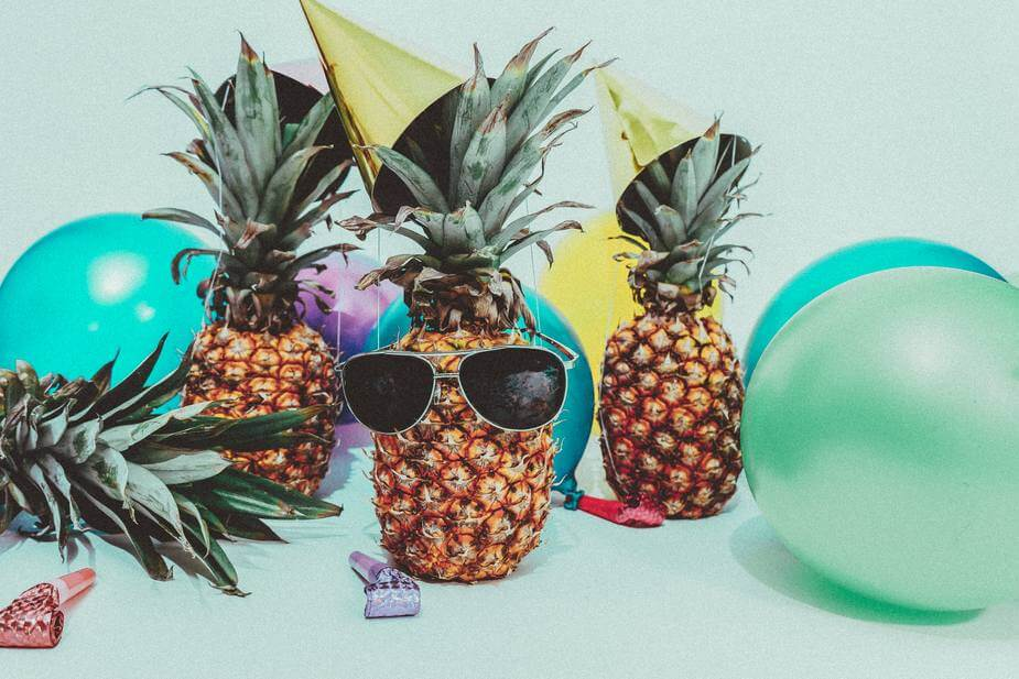 Four pineapples hang out at a pineapple party