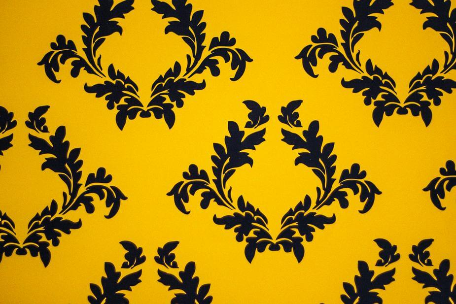 Yellow background with black filigree pattern