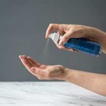 Applying Magnesium Oil Spray on the hand