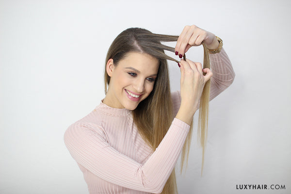 Take a big section of hair at the front and separate into three strands