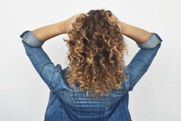 Naturally curly hair using curl enhancing cream