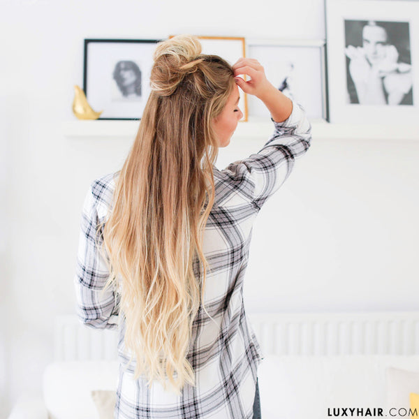 Half up hairstyle with top knot
