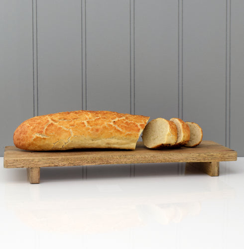 raised chopping board with bread