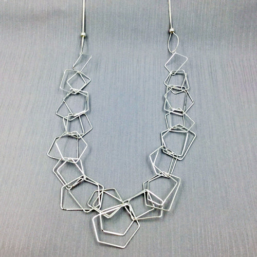 layered geometric long silver necklace