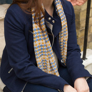 blue geo print scarf on model