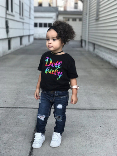 Girl's Trendy Tee and Distressed Jeans Outfit