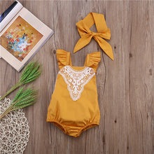 Load image into Gallery viewer, Image of a yellow romper from Safe Haven Baby with a white lace collar and matched hair bow.