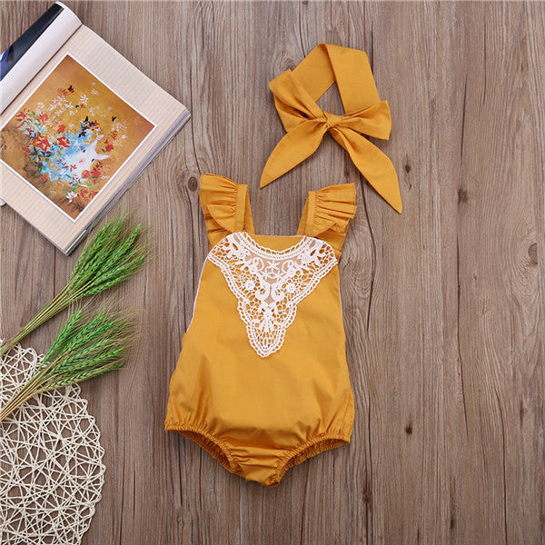 Image of a yellow romper from Safe Haven Baby with a white lace collar and matched hair bow.