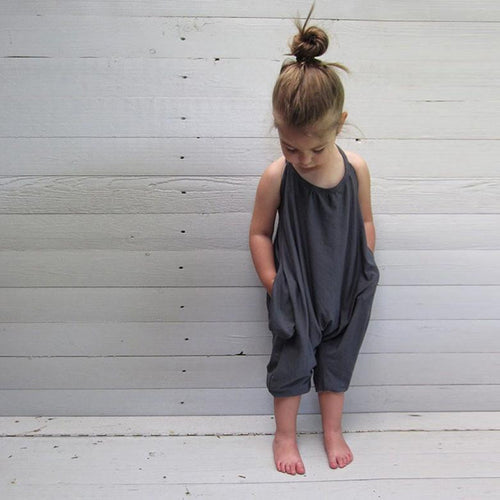 Picture of a toddler in a gray, sleeveless romper from Safe Haven Baby.