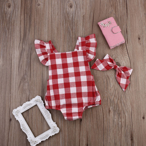 Image of a red and white checkered romper from Safe Haven Baby with a matched hair bow.