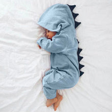 Load image into Gallery viewer, Picture of a sleeping newborn in a blue hooded jumpsuit with navy spines going down the head and back.