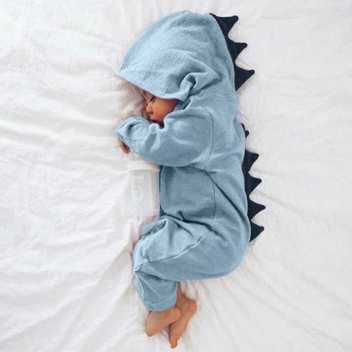 Picture of a sleeping newborn in a blue hooded jumpsuit with navy spines going down the head and back.