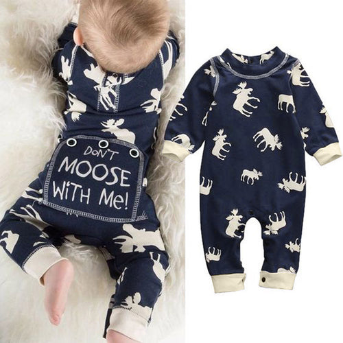 Picture of a baby laying on their stomach in a navy jumpsuit printed with cream moose. On the baby's bottom is a flap printed: don't moose with me!