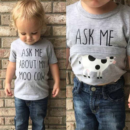 Picture of a toddler in a shirt reading: ask me about my moo cow. Flips up to reveal a cow on the underside of the shirt.