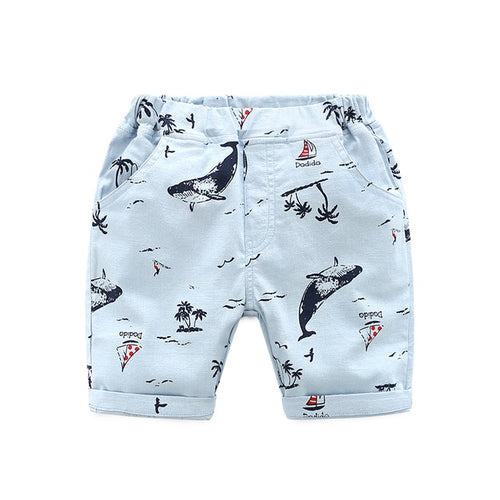 Image of a pair of white shorts printed with humpback whales and palm trees.