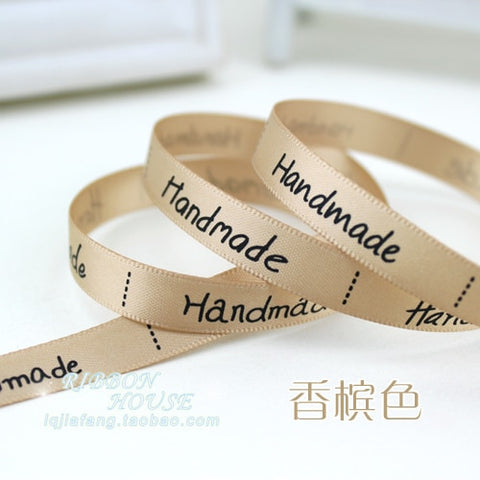 "Ribbon that says ""Handmade"" 2 m"