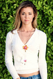 Samantha Lockwood in layered Fleurings necklaces with Fresh orchids