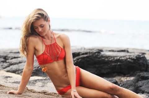 Actress and designer of Fleurings jewelry modeling her designs with a cute red bikini from Acacia Swimwear.  Photo produced by Studio 55 Boutique in Waimea, on the Big Island of Hawaii.
