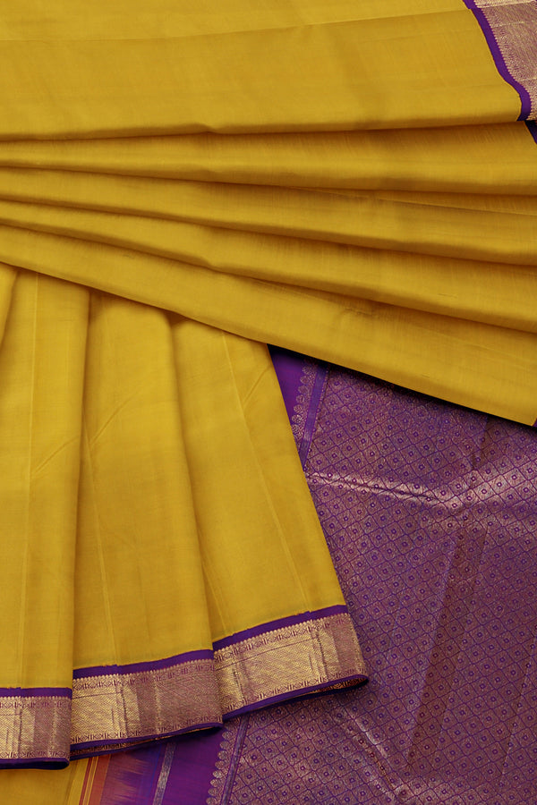Yellow Saree with Purple Border
