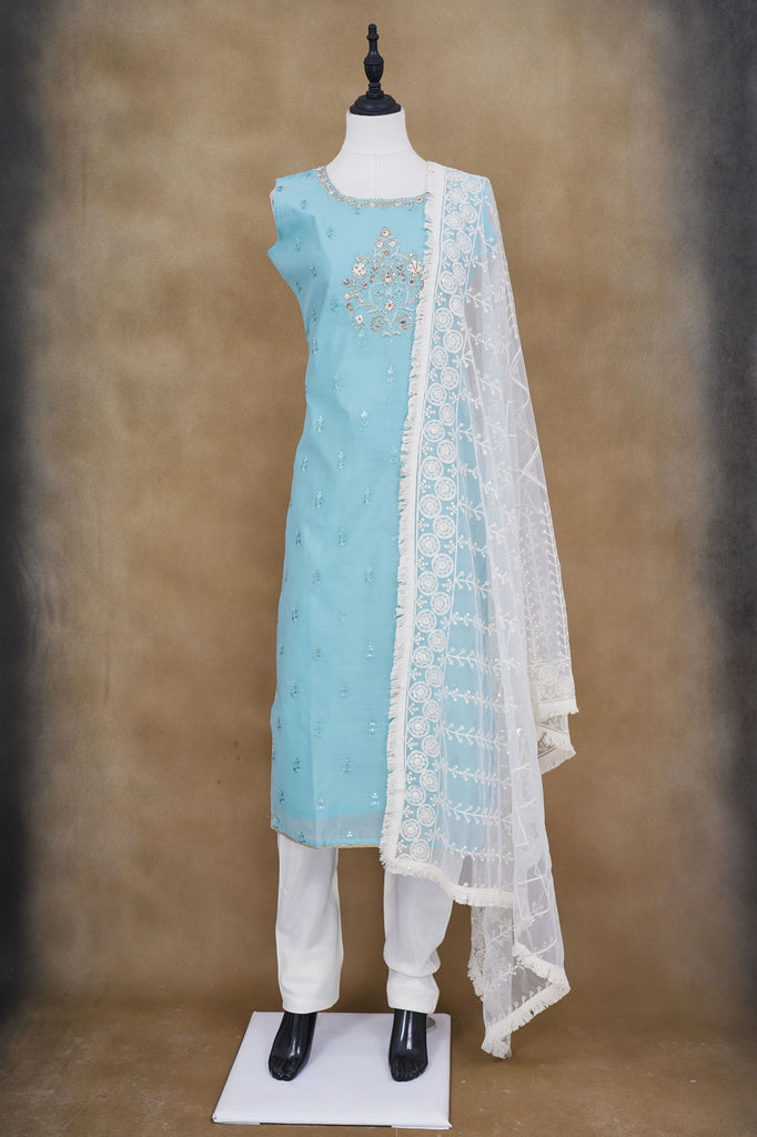 Light blue floral design top with white bottom and white shawl kurti
