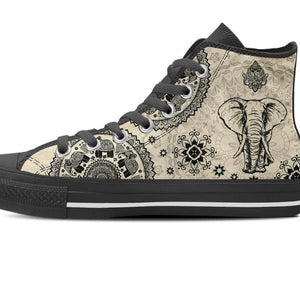 zoomed in light brown high top shoe elephant design