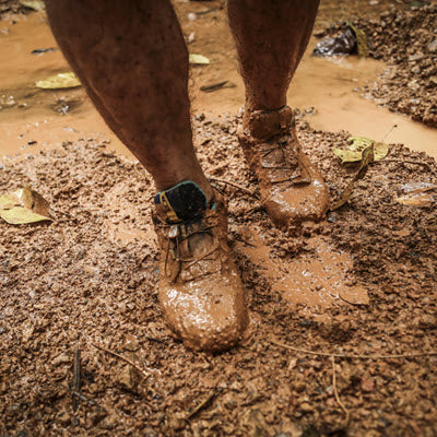 wet muddy running shoes