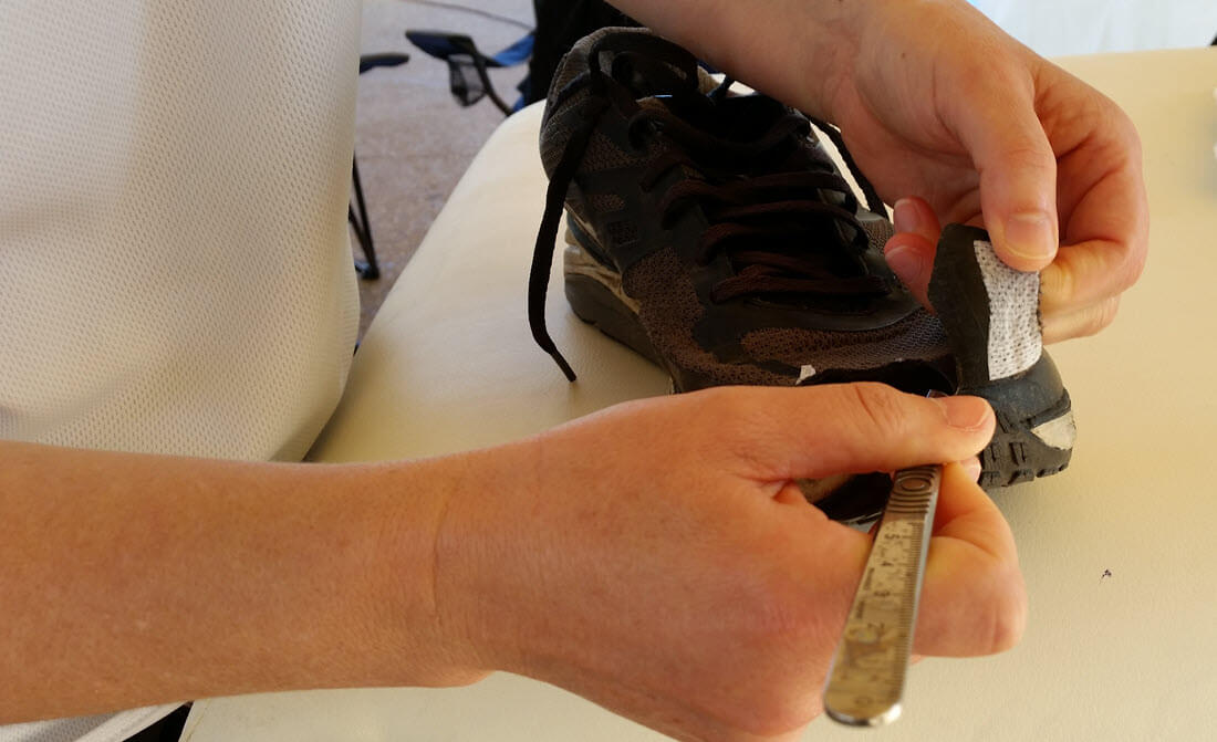cutting the shoe to give toenail blister relief