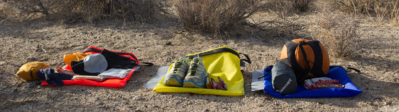Drop bags carrying dry shoes and socks, among other things - Image credit highdesertdropbags