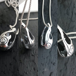 Different angles of Bealtaine flame pendant