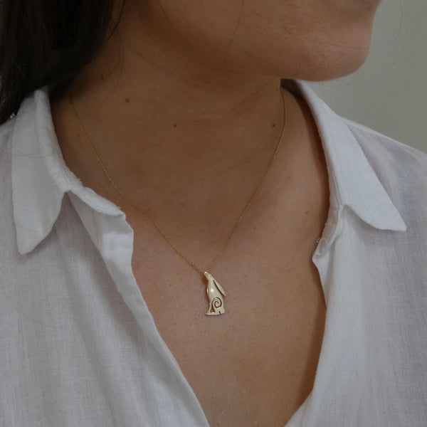 Woman wearing solid gold hare pendant with 9 carat gold chain