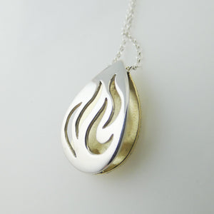 3d hollow pendant cut out silver flames backed with brass
