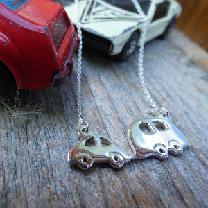 matchbox cars with silver adventurers necklace