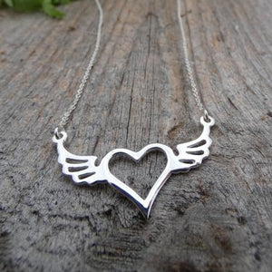 silver necklace with heart and wings