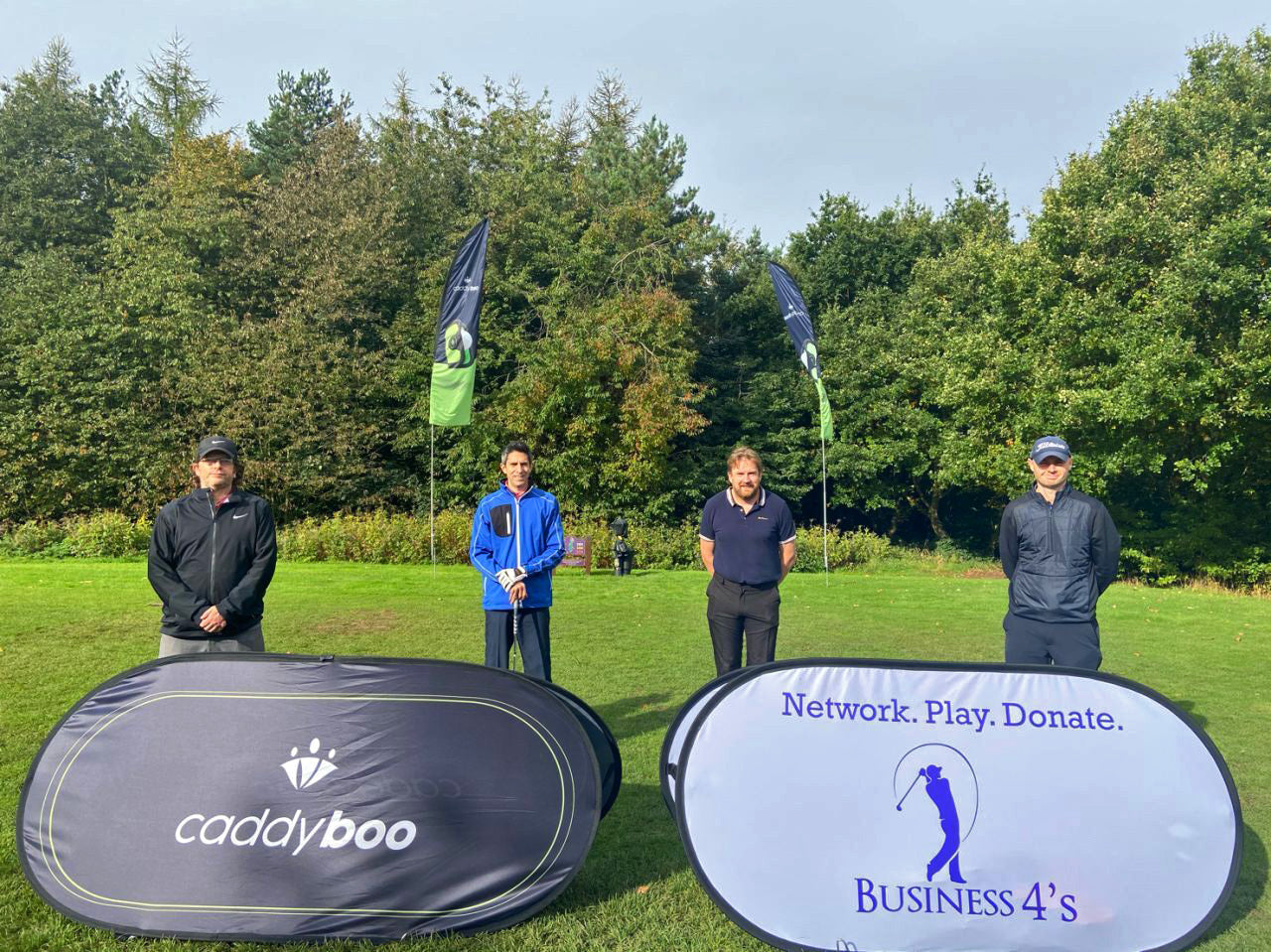 golfers at business fours event