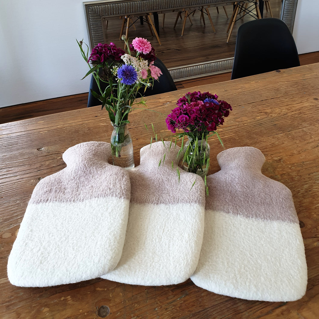 These hot water bottles are the perfect addition to your Wool Craft designed home. A simple but eye-catching design is met with outstanding quality and durability. A mixture of merino wool on the outside and rubber on the inside make sure to add this necessary requirement to your household. Perfect for keeping any liquid warm over long durations of time.